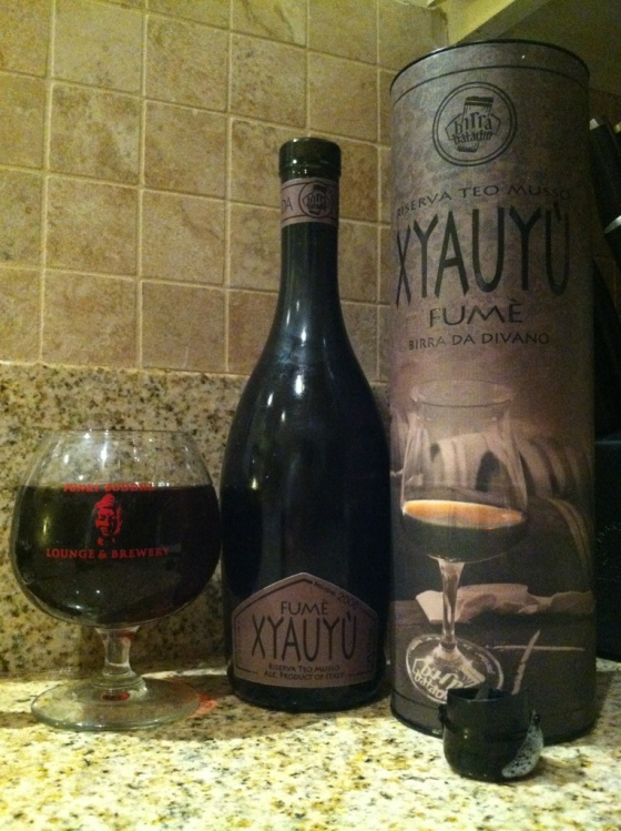A barleywine, that is flat, that is corked, that is capped, that is waxed, that is in a circle box: Xyauyuception